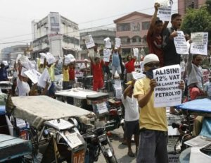 Taxi drivers take their grievances onto the streets of Manila