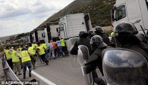 Clashes: Spanish police arrive to break up a picket line by striking Spanish truckers in Iznalloz, near Granada
