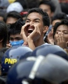Manila students yell at police blocking their march on the Presidential Palace.
