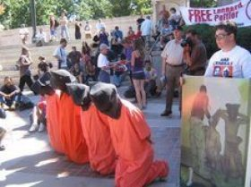 Advocates for human rights at the Political Prisoners March in Denver on Monday. During street theater at the courthouse, activists simulated US waterboarding and torture. Photo Brenda Norrell
