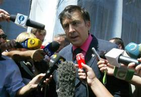 Georgian President Mikhail Saakashvili speaks to the media in Tbilisi, Georgia, on Wednesday, Aug.13. (Shakh Aivazov / AP)