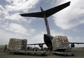 U.S. Air Force servicemen and workers unload humanitarian aid from a U.S. Air Force cargo plane at Tbilisi airport August 14, 2008.