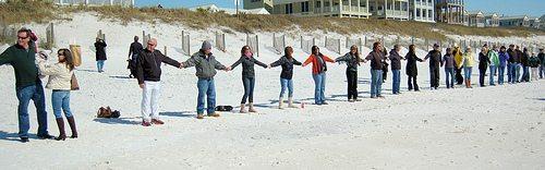 hands cross sand 02