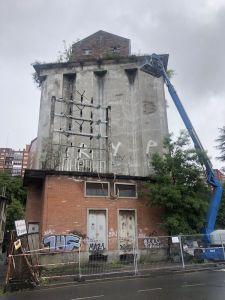 Picado del revocado de las fachadas