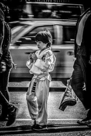 Monochrome: Photograph of young boy in Karate outfit