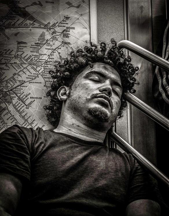 Monochrome Portrait of sleeping man with curls