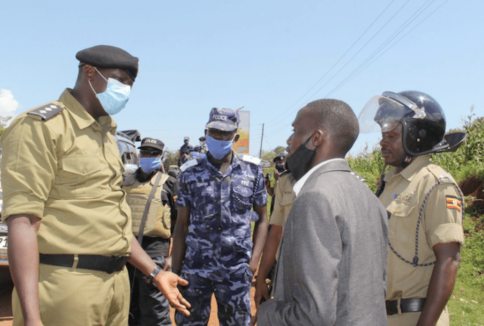The officer in charge of Jinja city police station, Moses Kamomo engages John Katumba