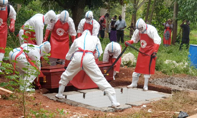 Uganda Red Cross Society safe and dignified burial team conducting a COVID burial recently