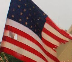 An American flag waves during an historic re-enactment in Buxton, NC. (photo: Artz Music & Photography)