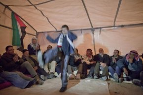 Ez Za'im (---), 12/01/2013.- A Palestinian boy dancing to nationalistic Palestinian songs in a tent in the new 'outpost' called Bab al-Shams (Gate of the Sun), 12 January 2013, erected outside the Palestinian village of Ez Za'im in the contentious E1 area east of Jerusalem, in the West Bank. The Palestinians, joined by some foreign activists are doing this action, they say, as a means of non-violent, peaceful resistance to Israeli expansions of settlements on Palestinians' lands. EFE/EPA/JIM HOLLANDER