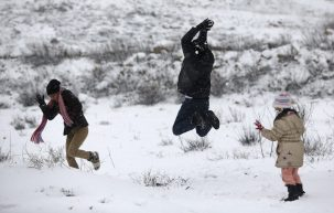 Palestinians play in the snow in the West Bank city of Ramallah January 10, 2013. At least 17 people have died due to a storm in Lebanon, Jordan, Turkey, Israel and the Palestinian territories. Meteorological agencies in Israel and Lebanon both called it the worst storm in 20 years. REUTERS/Mohamad Torokman