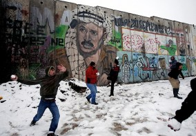 Jan 10, 2013 Palestinians play in the snow next to a section of Israel's barrier