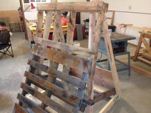 Pallet easel designed and built by Steve and Luca to facilitate pallet disassembling