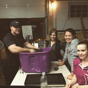 Seed Starting for the May 13th Plant Sale with help from the Community Issues & Service Learning students at UW Madison!