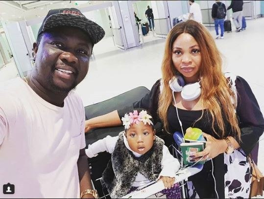 Seyi Law with wife and daughter