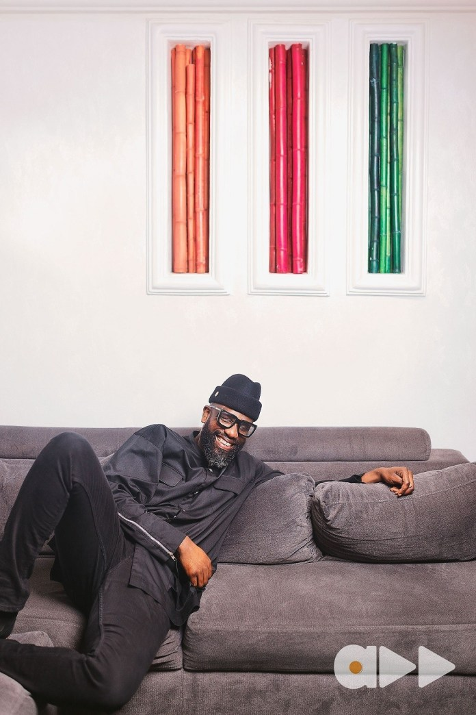Mai Atafo relaxes in urban wear for his Accelerate TV editorial