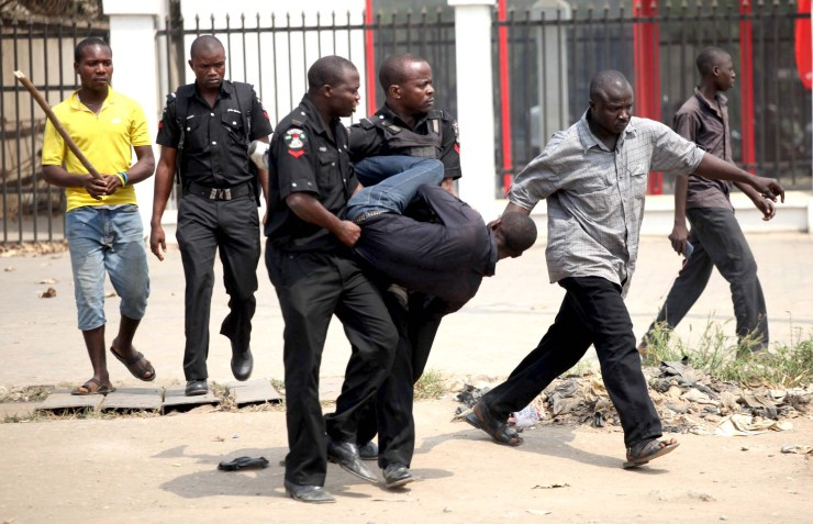 Image result for nigerian police arrest  JUST AFTER INNOSON WON BATTLE AGAINST GTB, MAN CLIMBS VERY HIGH MAST, CRASHES INTO BANK THROUGH THE ROOF IN IBADAN [VIDEO] 0a6ee4625ff57f49de289b811f64b8a2