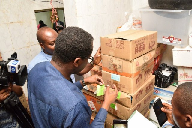 Image result for Nigerian Federal government shuts down a Chinese supermarket following outbreak of Coronavirus
