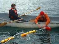 Andrew attaches the water intake to a float