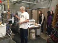 Jim shows the students the lab