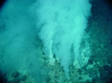 Hydrothermal vent expelling hot fluid into the surround sea water. https://upload.wikimedia.org/wikipedia/commons/thumb/d/df/Hydrothermal_vents_map.svg/1000px-Hydrothermal_vents_map.svg.png