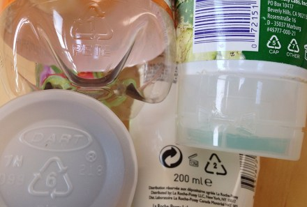 Many materials will have a recycling symbol imprinted on them somewhere. The numbers and letters associated with the arrows encode specific information for workers. [Wikimedia]