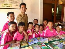 Eddi a teacher at SD2 Kayu Puti. This school does not have a library and just one table of books. They were very happy to receive the new books.