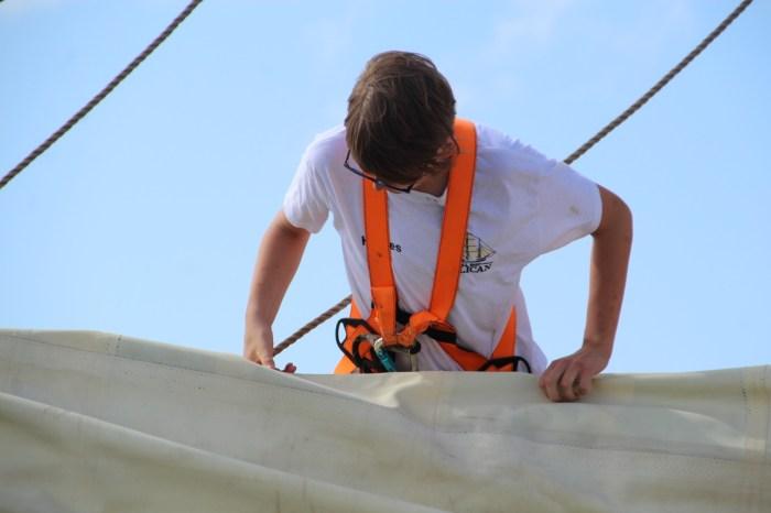 student handling sails