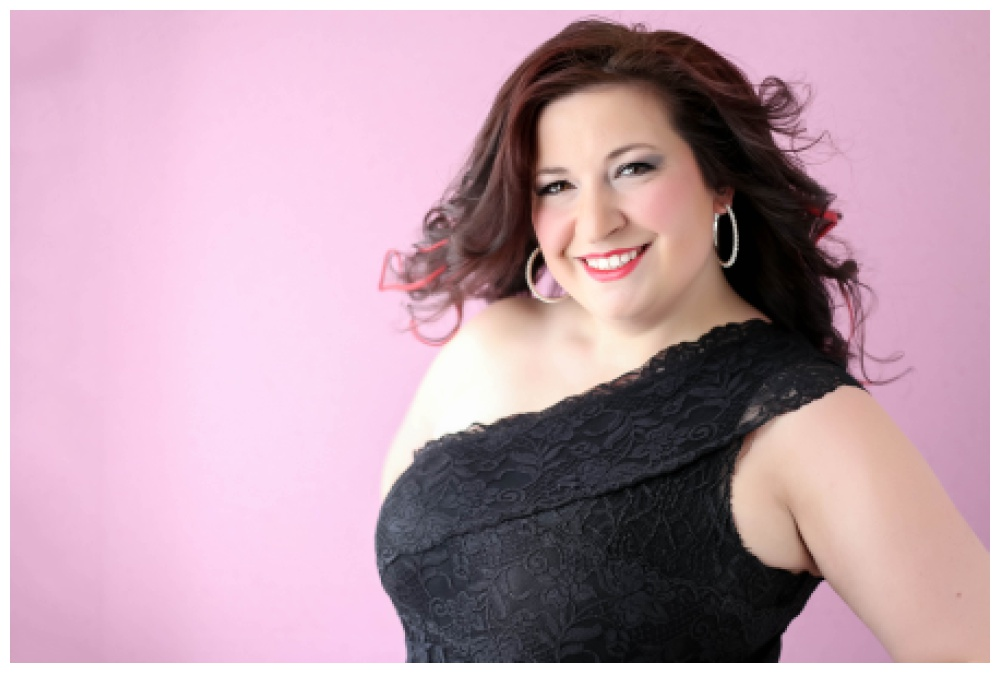 Boudoir photo of a woman on a pink background