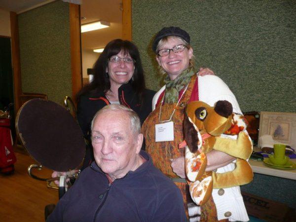 June Wood of Smart Move Services Estate Liquidation with Oceanside Stroke Recovery Society volunteer, Karen & member, Rick