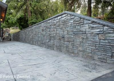 Eastern ledgestone retaining wall and royal ashler slate concrete stamping.