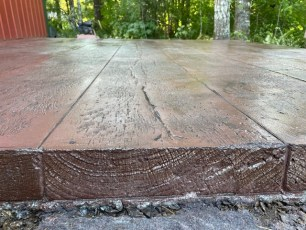 Reclaimed lumber concrete stamp with end grain cuts by Concrete Installer