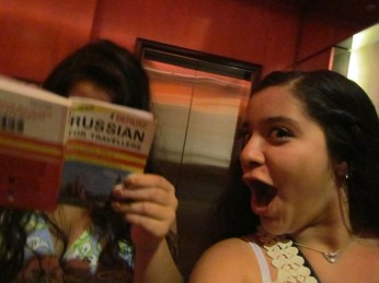 sister taking a selfie before the 1D concert. me... reading...