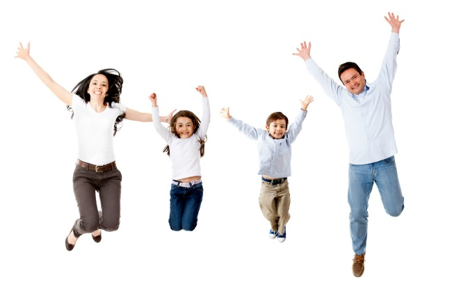 Happy family jumping - isolated over a white background