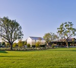 The neighborhood greenhouse and expansive lawn at Pavilion Park.