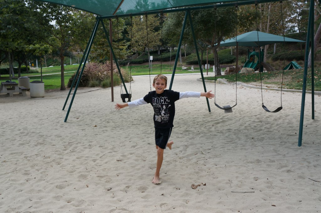 Riding Swings at Park