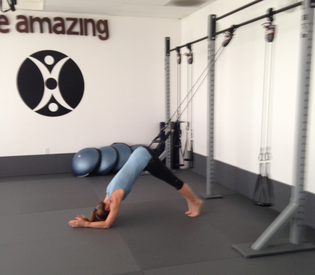 a client stretching prior to working out