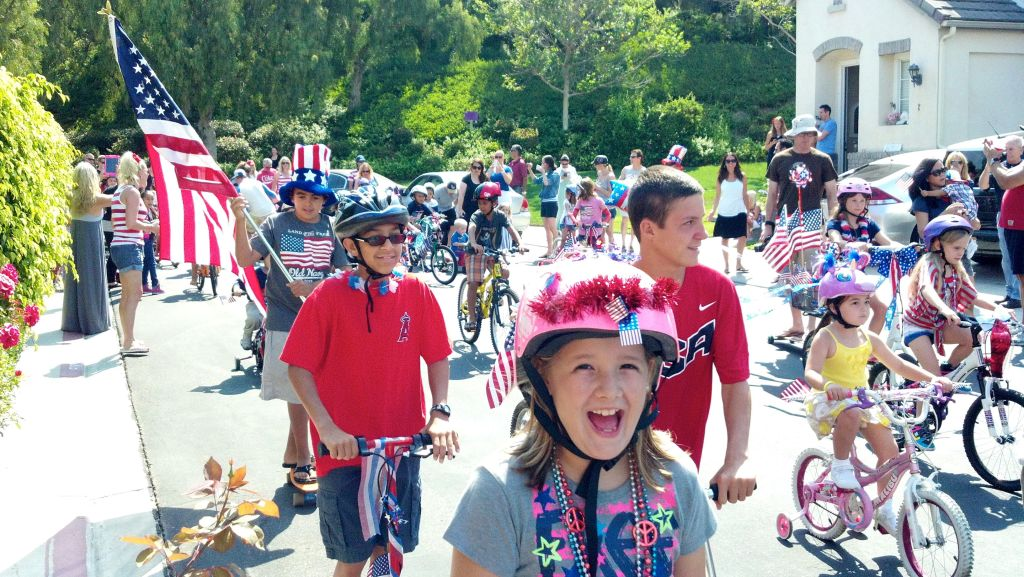 My smiling daughter enjoying our neighborhood's Fourth of July Bike Parade.