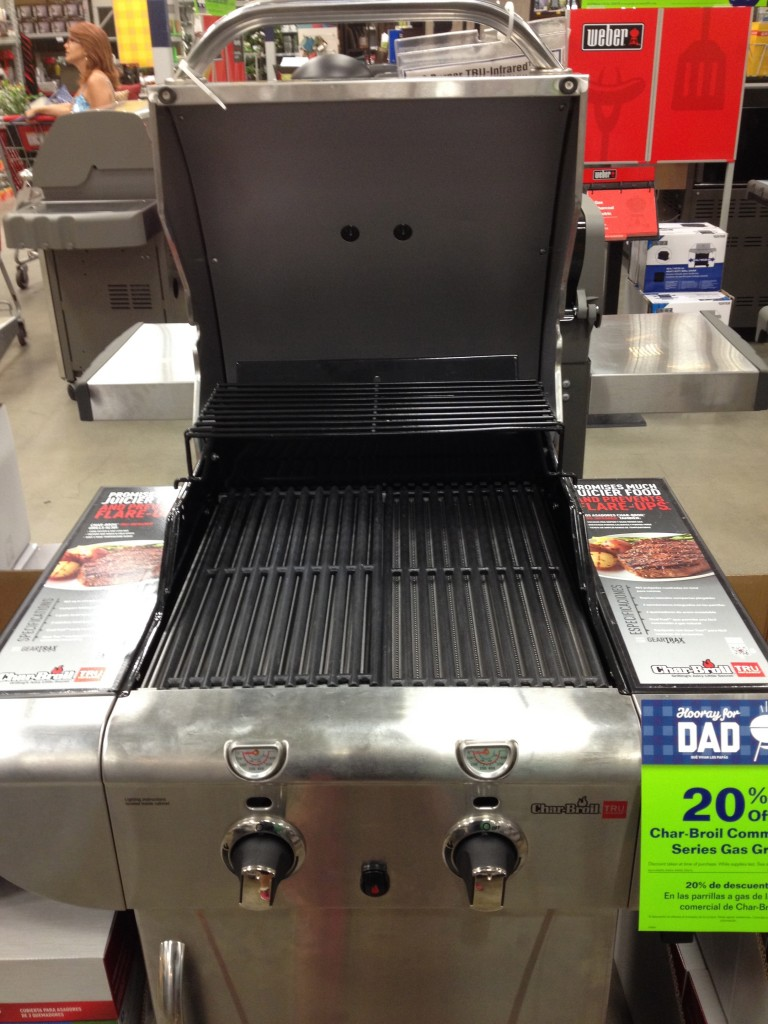 A smaller, two-tiered barbecue (propane) for different types of food.