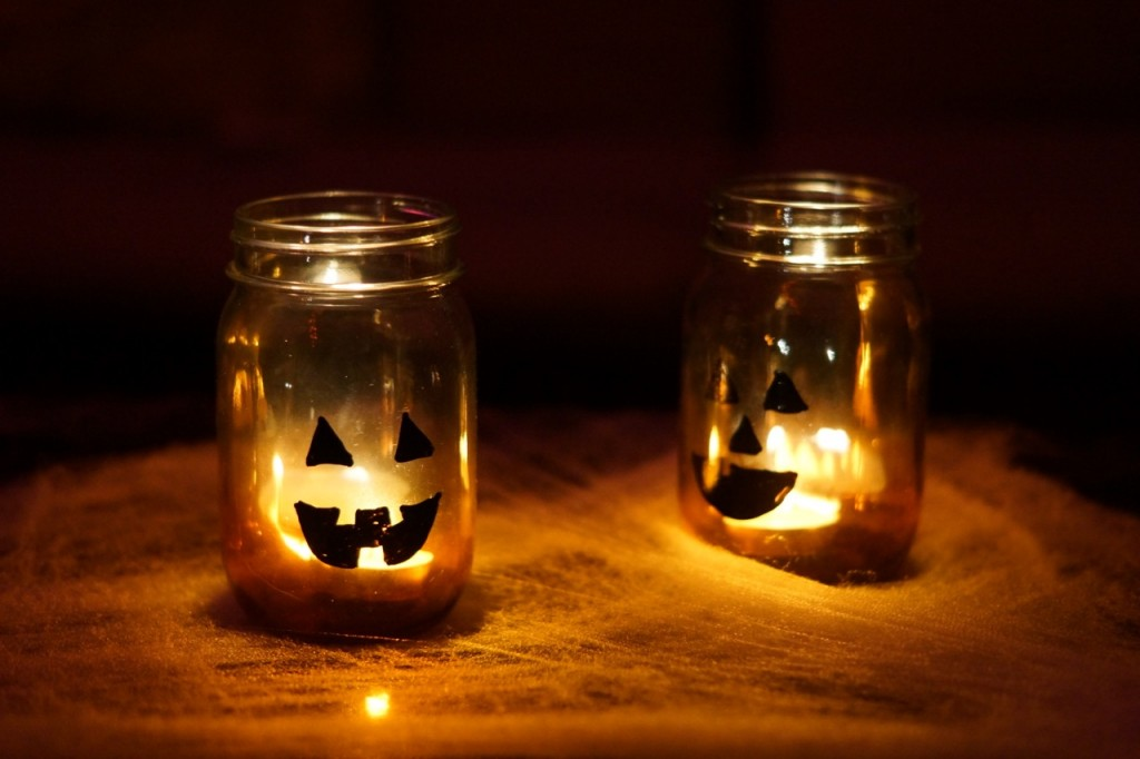 Jack-o-lantern mason jars glowing at night