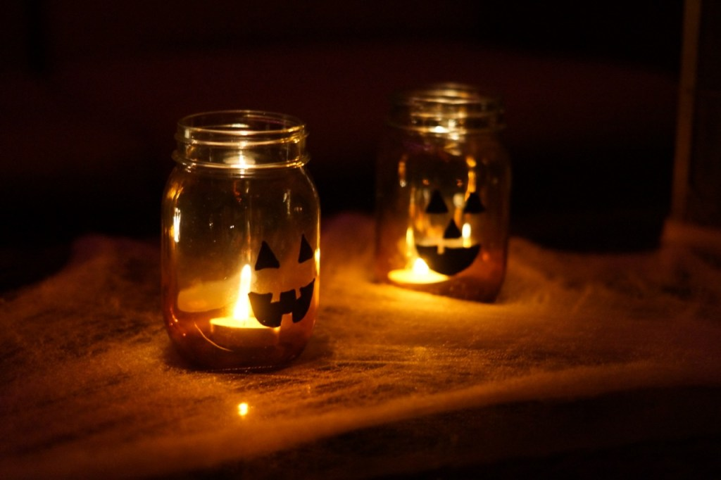 The jack-o-lantern mason jar candle holders glowing at night