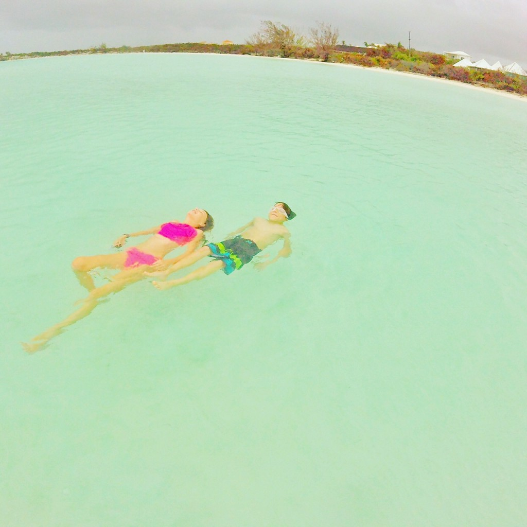 Kids floating in the waters of Taylor Bay in the Turks and Caicos