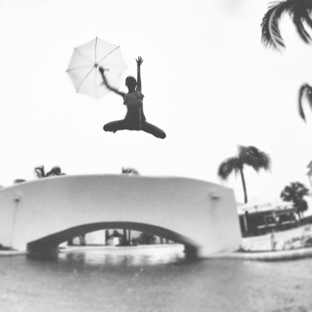 Jumping into the pool during a rain storm in the Turks and Caicos