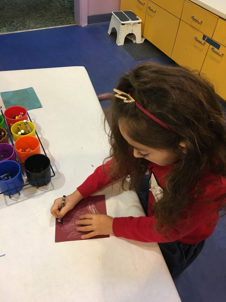 Doing crafts in the Pretend City Art Studio