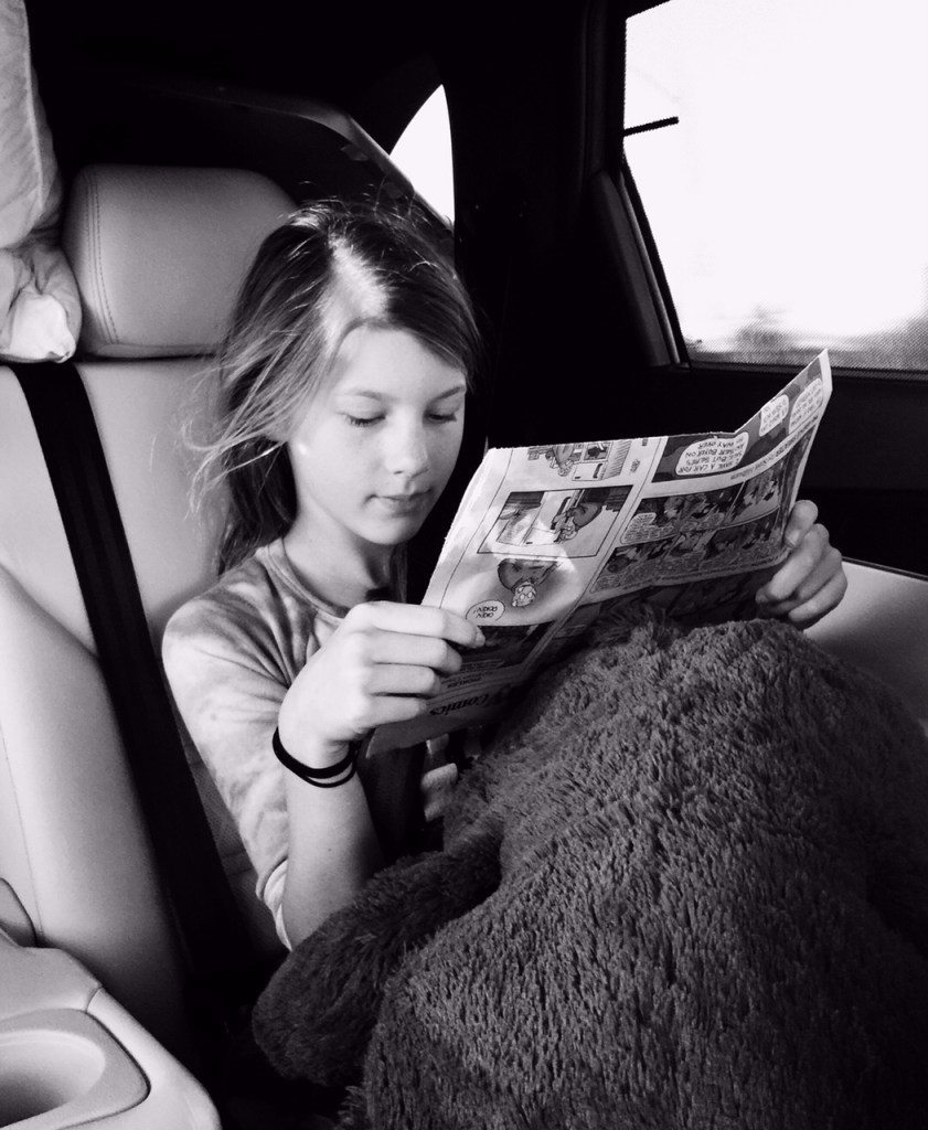 Reading the Newspaper in the Kia Sorento