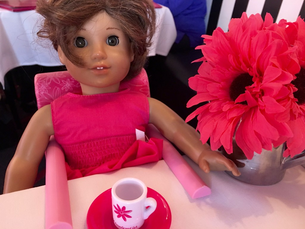 American Girl Doll in a high chair