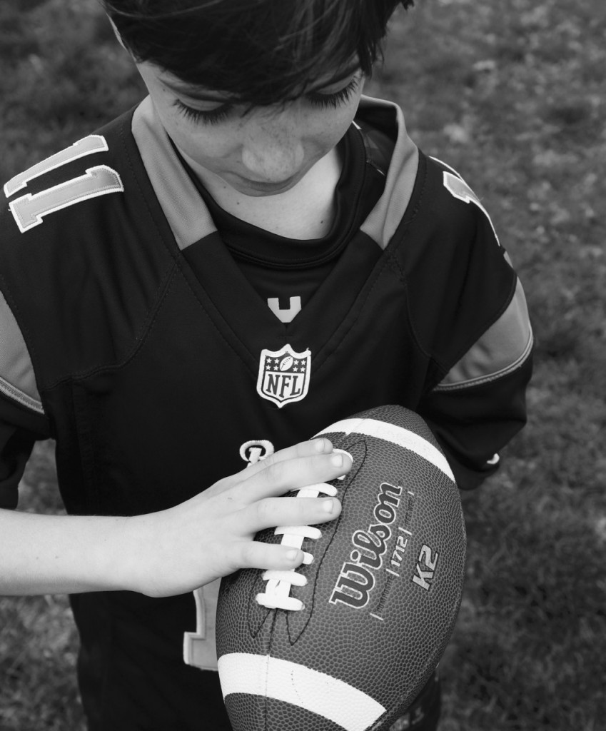 Kid holding a football