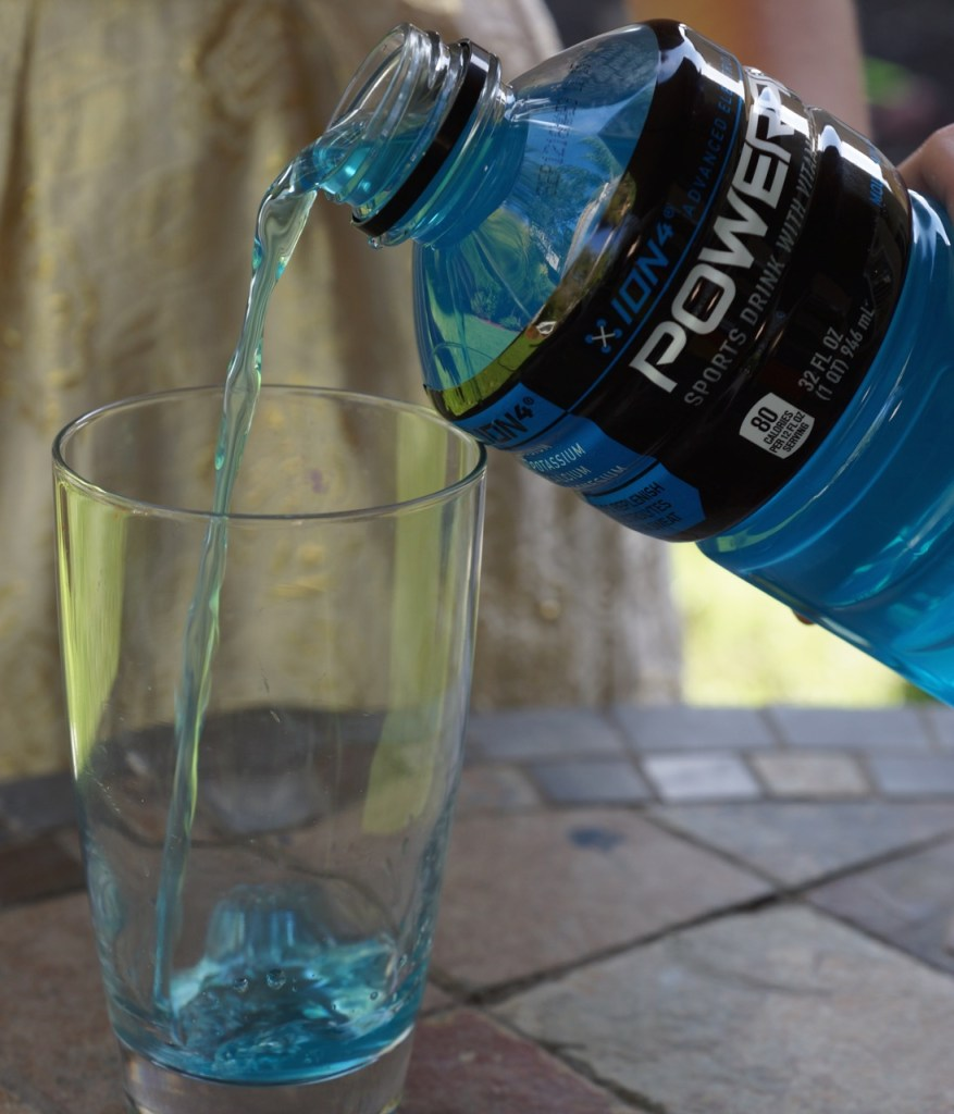 pouring powerade for young athletes