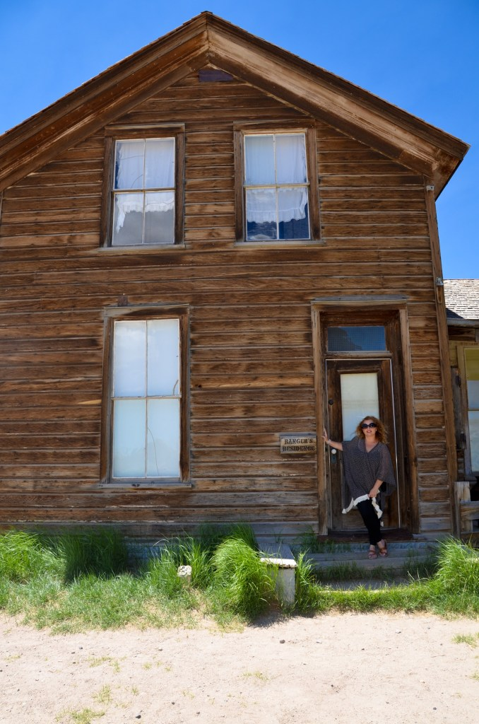 Naz in front of a Bodie home