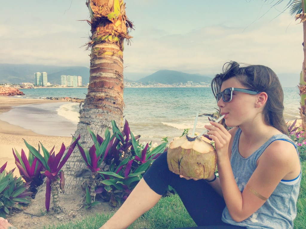 Sipping on coconut water in Puerto Vallarta